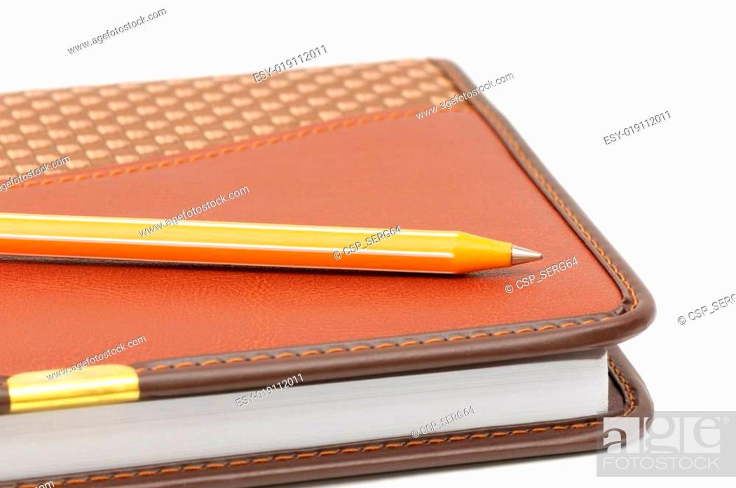 Stock Photo: Notebook and ball-point pen.