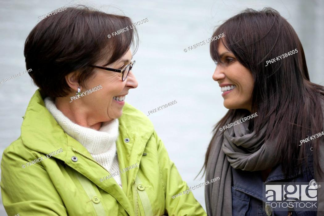 Stock Photo: Two women talking to each other.