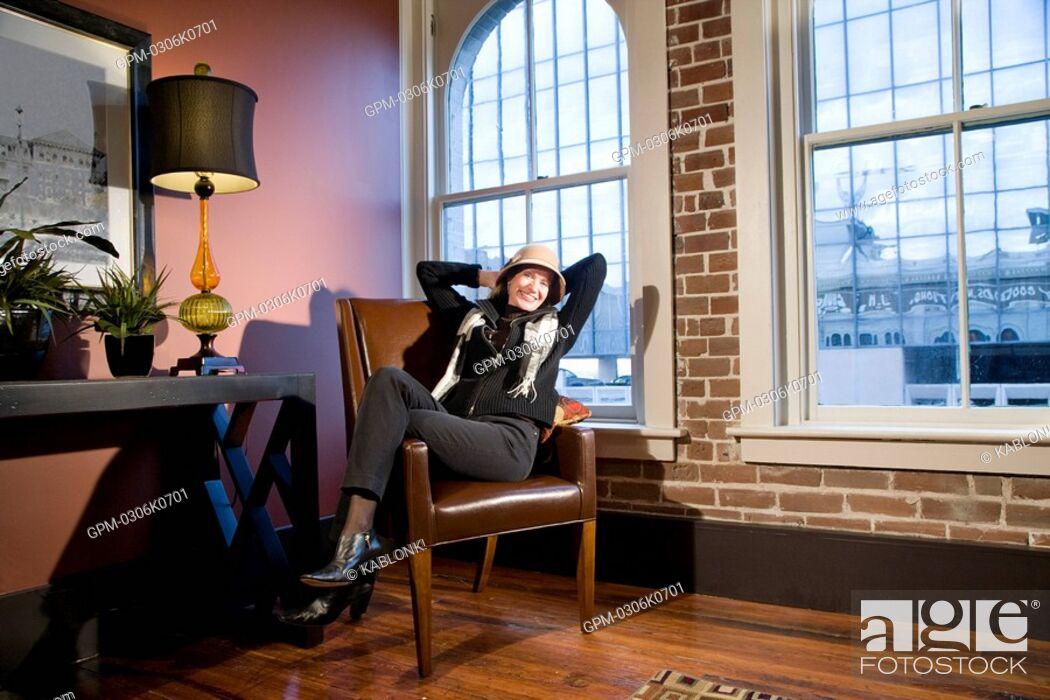 Imagen: Portrait of mature woman sitting in modern downtown loft.