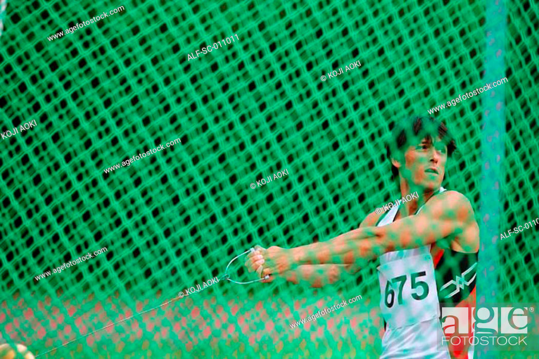 Stock Photo: Male Hammer Thrower Winding Up.