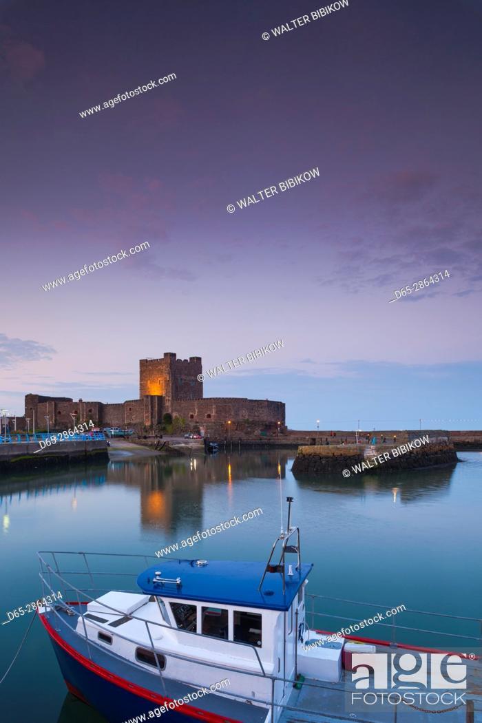 Stock Photo: UK, Northern Ireland, County Antrim, Carrickfergus, Carrickfergus Castle, 1177, Ireland's oldest Norman castle, dusk.