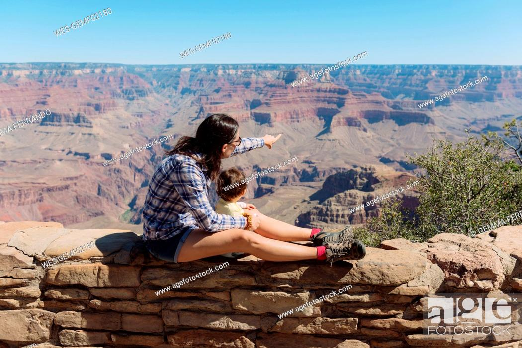 Stock Photo: USA, Arizona, Grand Canyon National Park, Grand Canyon, mother and little daughter looking at view.