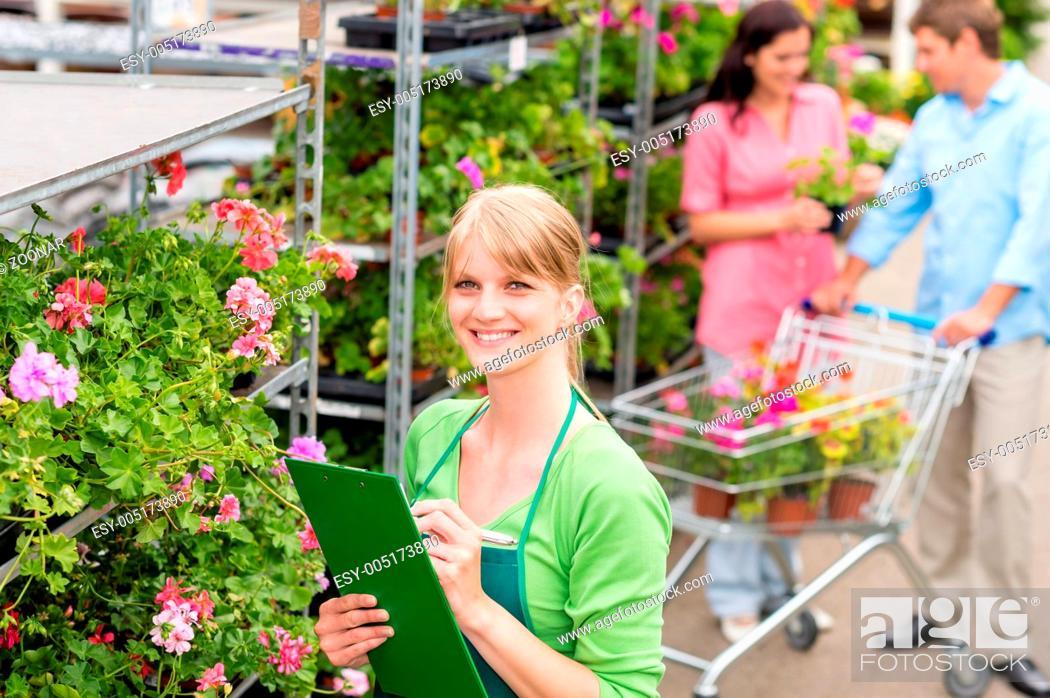 Stock Photo: Florist at garden centre retail inventory.