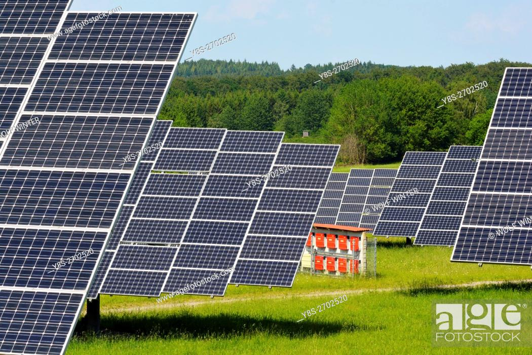 Stock Photo: Solarpark Mengeringhausen with static Modules and Modules, that follow the Azimuth of the Sun. They produce electricity in any position and angle.