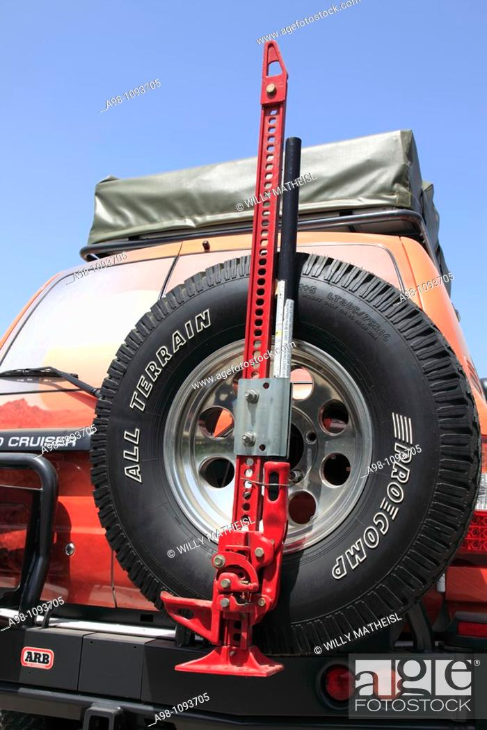 Stock Photo: car-jack on spare tire of a Toyota Land Cruiser four wheel drive in the Sultanate of Oman, Middle East.