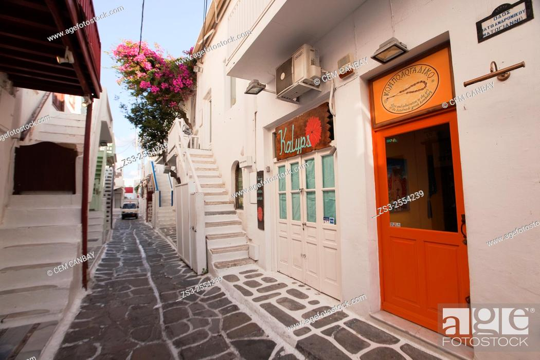 Stock Photo: Whitewashed houses with colorful doors and railings in town center, Mykonos, Cyclades Islands, Greek Islands, Greece, Europe.