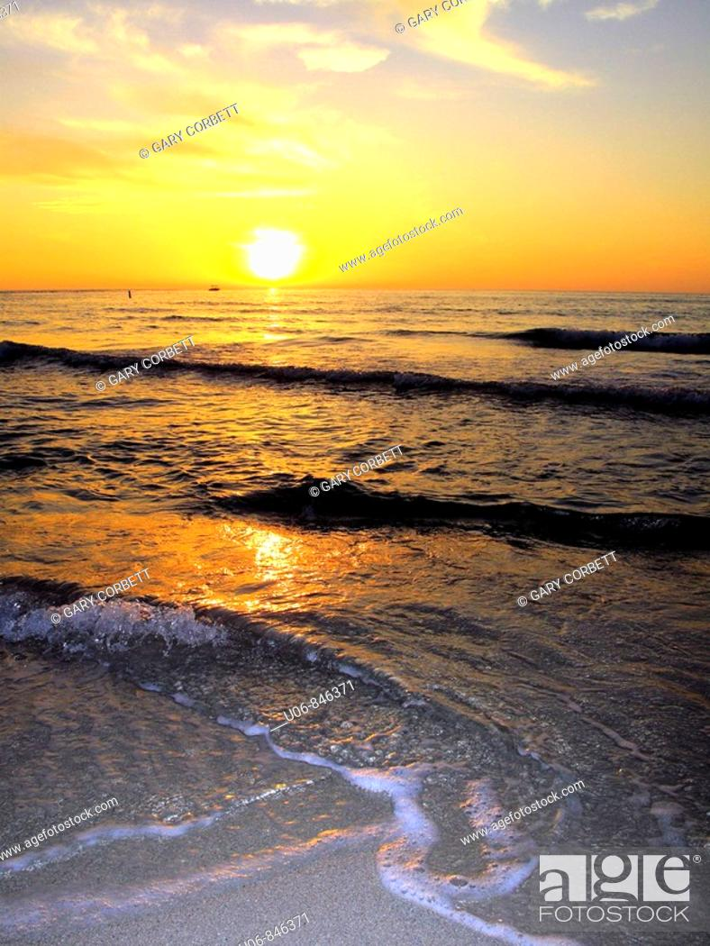 Stock Photo: A sunset and surf at beach in southwest, Florida, USA.