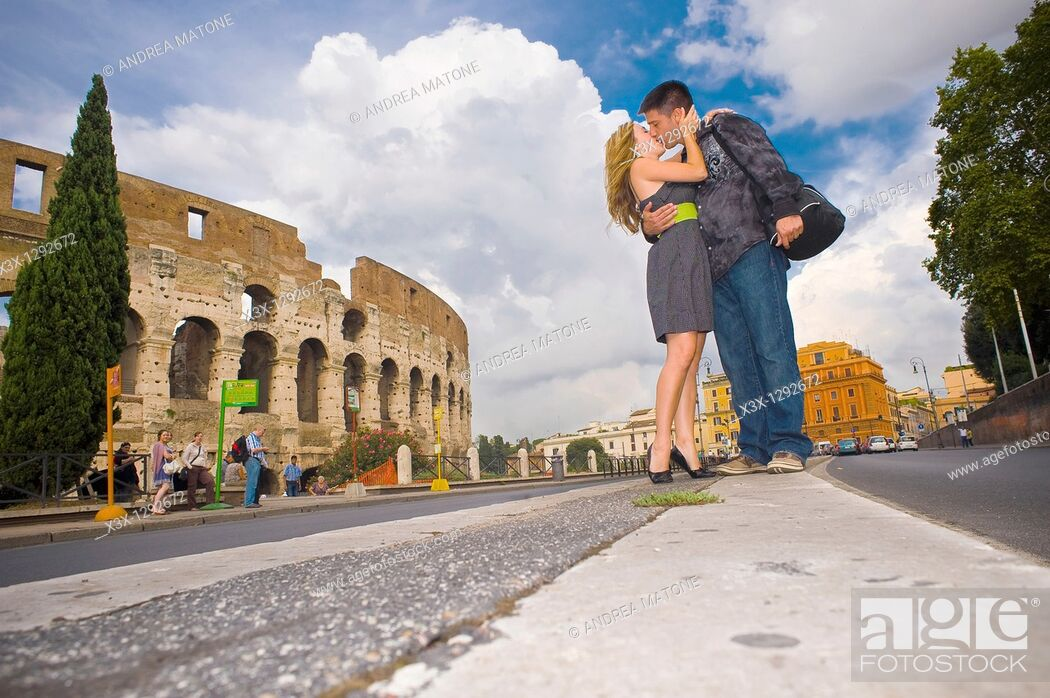 Stock Photo: Couple kissing on the street before the Roman Colosseum in Rome Italy.
