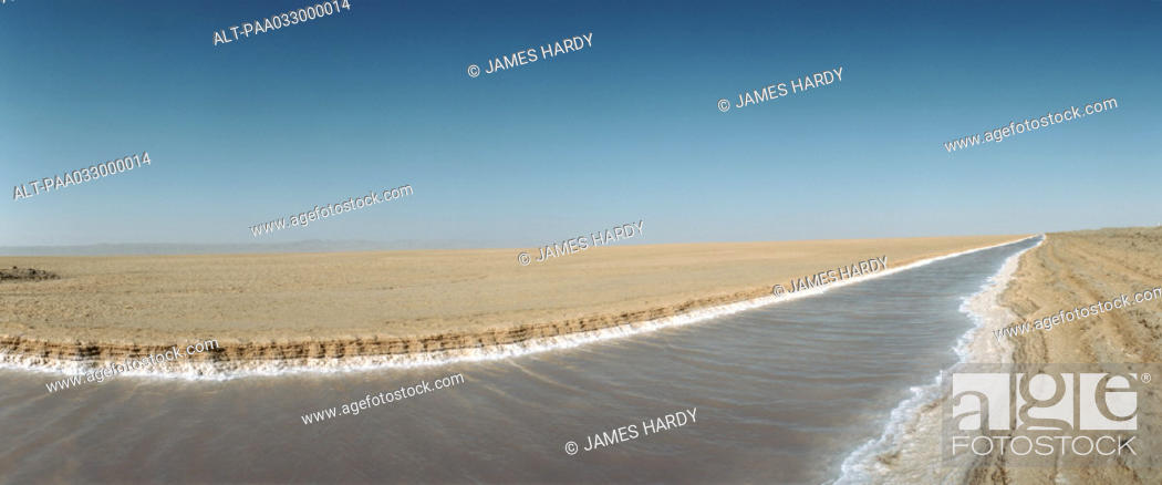 Stock Photo: Tunisia, canal in desert landscape, panoramic view.