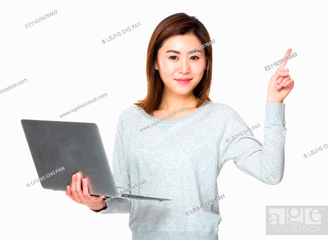 Stock Photo: Asian Woman hold with laptop computer and finger point up.