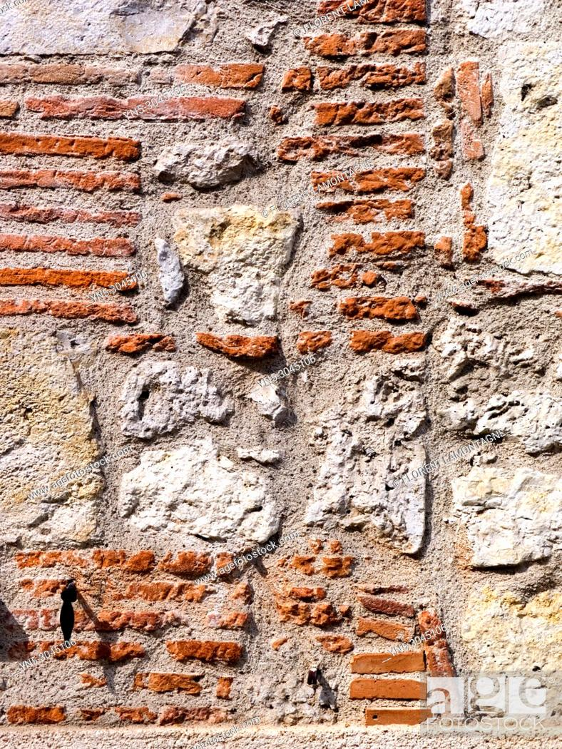 Stock Photo: Structure of stones wall in southwest of France made with limestone and bricks.