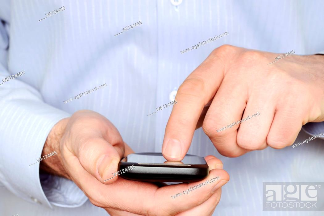 Stock Photo: Man Using a Smartphone, Close Up.