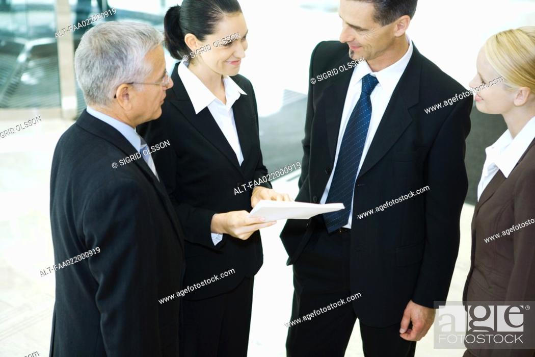 Photo de stock: Business associates standing together, smiling, high angle view.