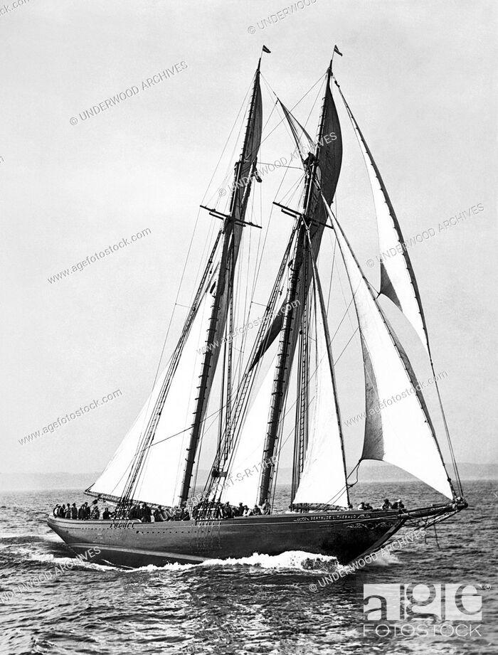 Stock Photo: Massachusetts: c. 1935.The racing fishing schooner, Gertrude L. Thebaud, under full sail.