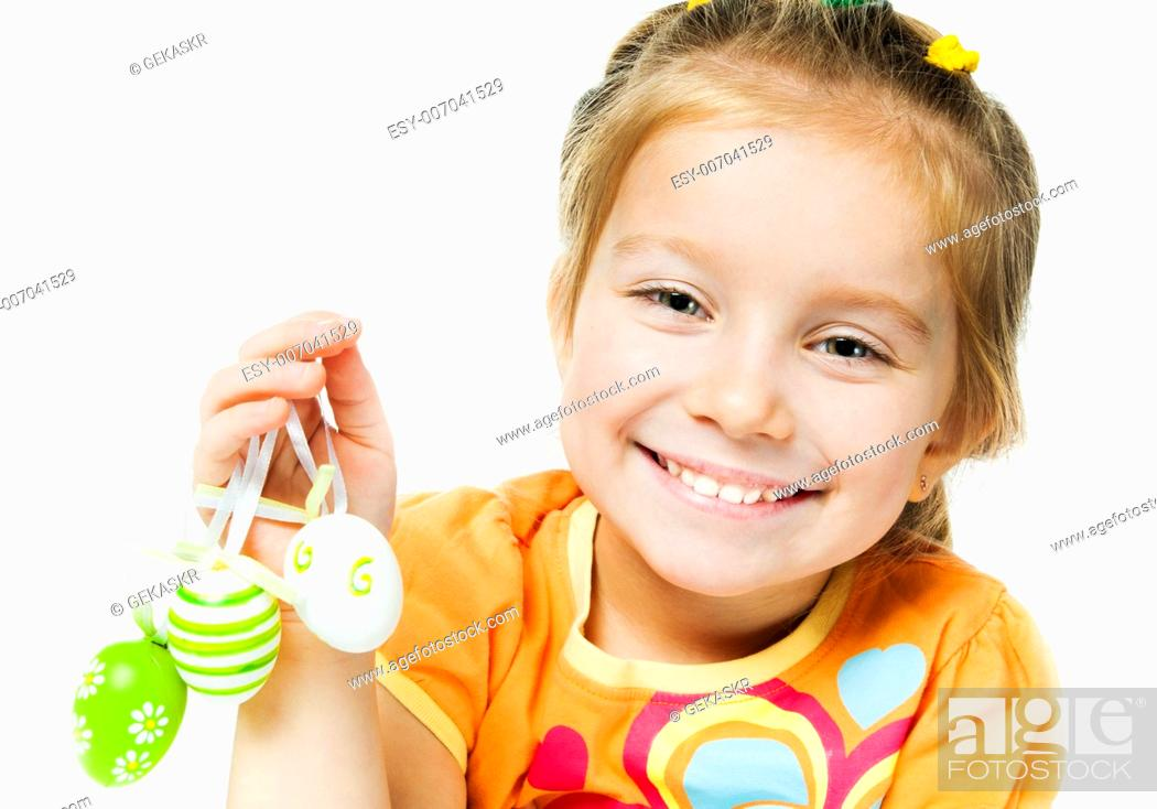 Stock Photo: Smiling little girl with easter eggs. Isolated on white.