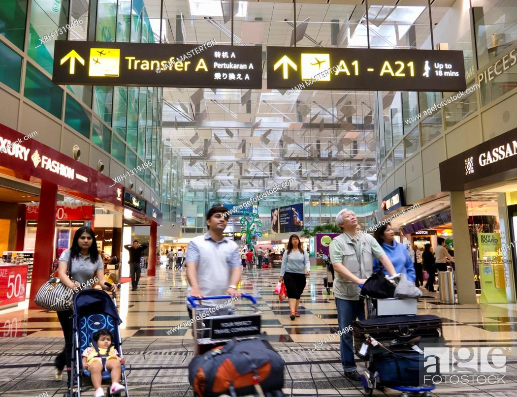 Stock Photo: Interior of new Terminal 3 at Changi Airport in Singapore.