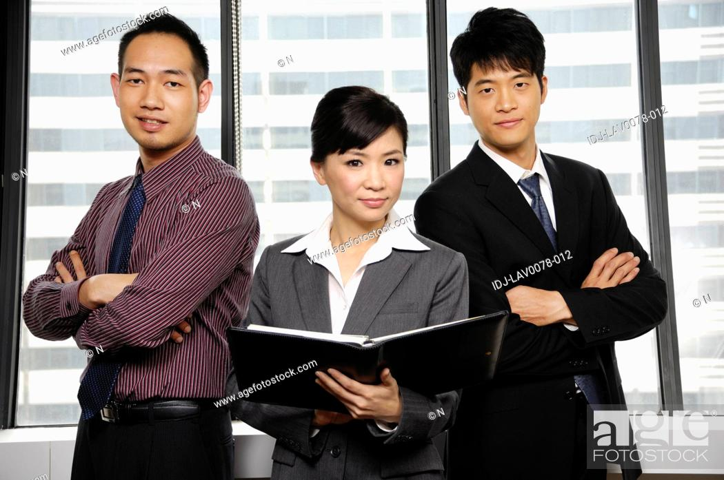 Stock Photo: Business executives standing in an office.