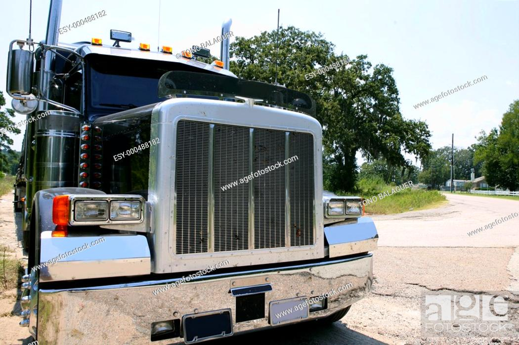 Stock Photo: Black huge lorry american truck with stainelss steel in green outdoor.