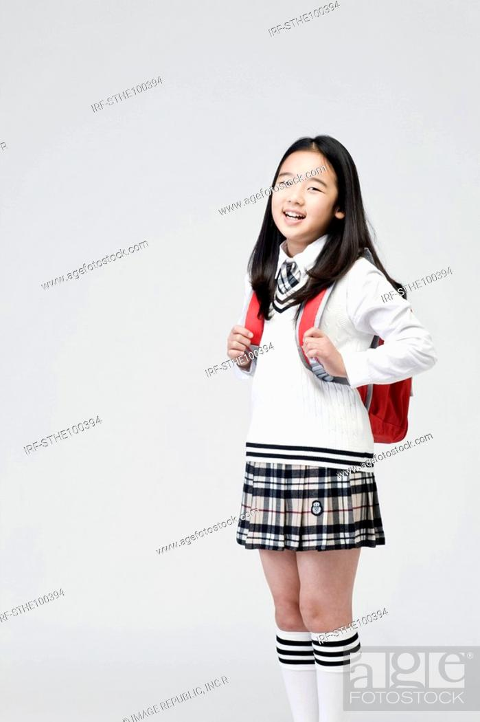 Stock Photo: girl carry a school bag over her shoulder.