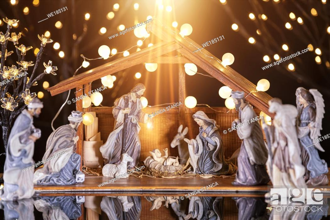 Stock Photo: Christmas Manger scene with figurines including Jesus, Mary, Joseph, sheep and wise men. Focus on baby!.