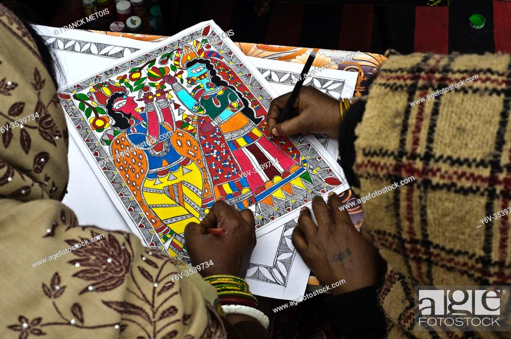 Stock Photo: Drawing lesson in a Madhubani style drawing school ( Madhubani, Bihar, India). The Madhubani ( or Mithila) style of painting is an art form practiced in.