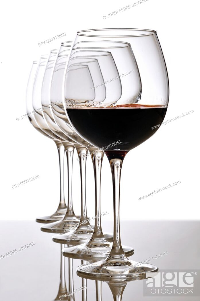 Stock Photo: red wine glass and empty glasses.