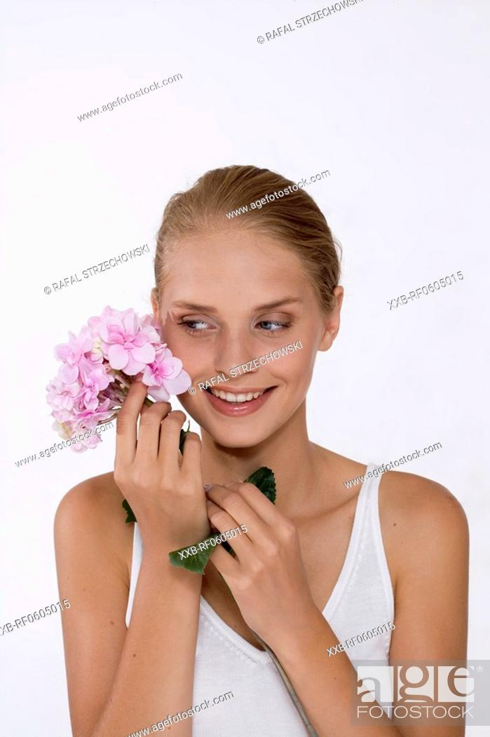 Stock Photo: young woman with hydrangea.