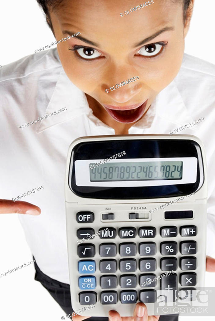 Stock Photo: Portrait of a businesswoman holding a calculator with her mouth open.