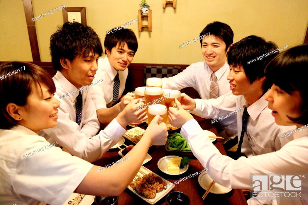 Stock Photo: Japanese business people drinking at a Japanese style Izakaya.