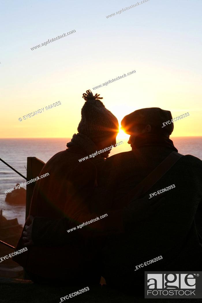 Stock Photo: Couple watching a sunset.