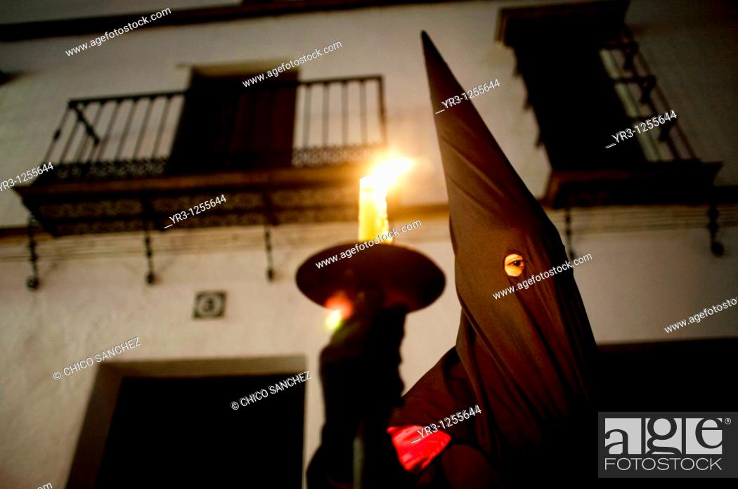 Stock Photo: A penitent participates in a Holy Week procession in the town of Prado del Rey in southern Spain's Cadiz Sierra region in Andalucia.
