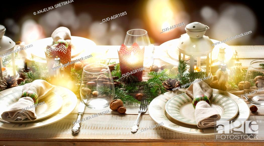 Stock Photo: Christmas table setting. Holiday Decorations.