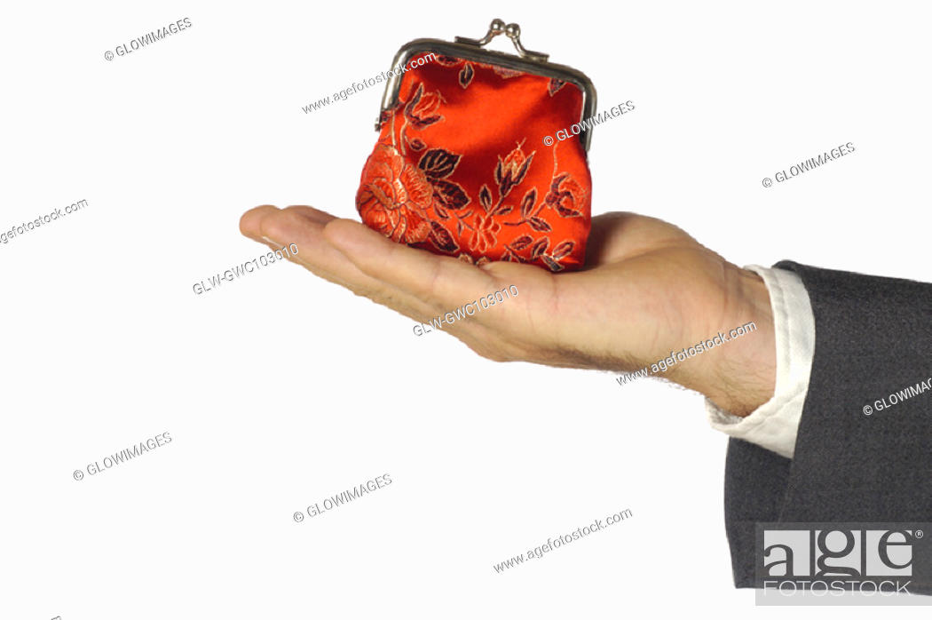 Stock Photo: Close-up of a businessman holding a change purse.