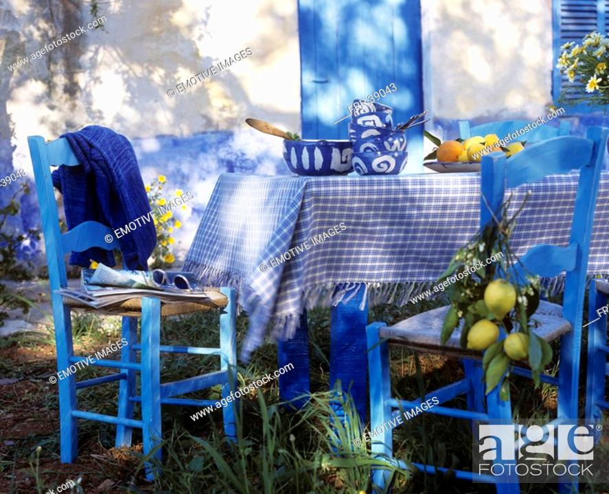 Stock Photo: Blue and white table with lemon.