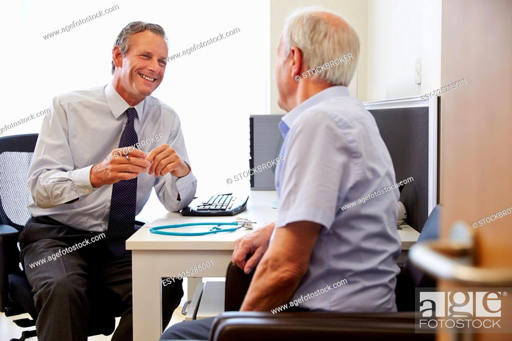 Stock Photo: Senior Patient Having Consultation With Doctor In Office.
