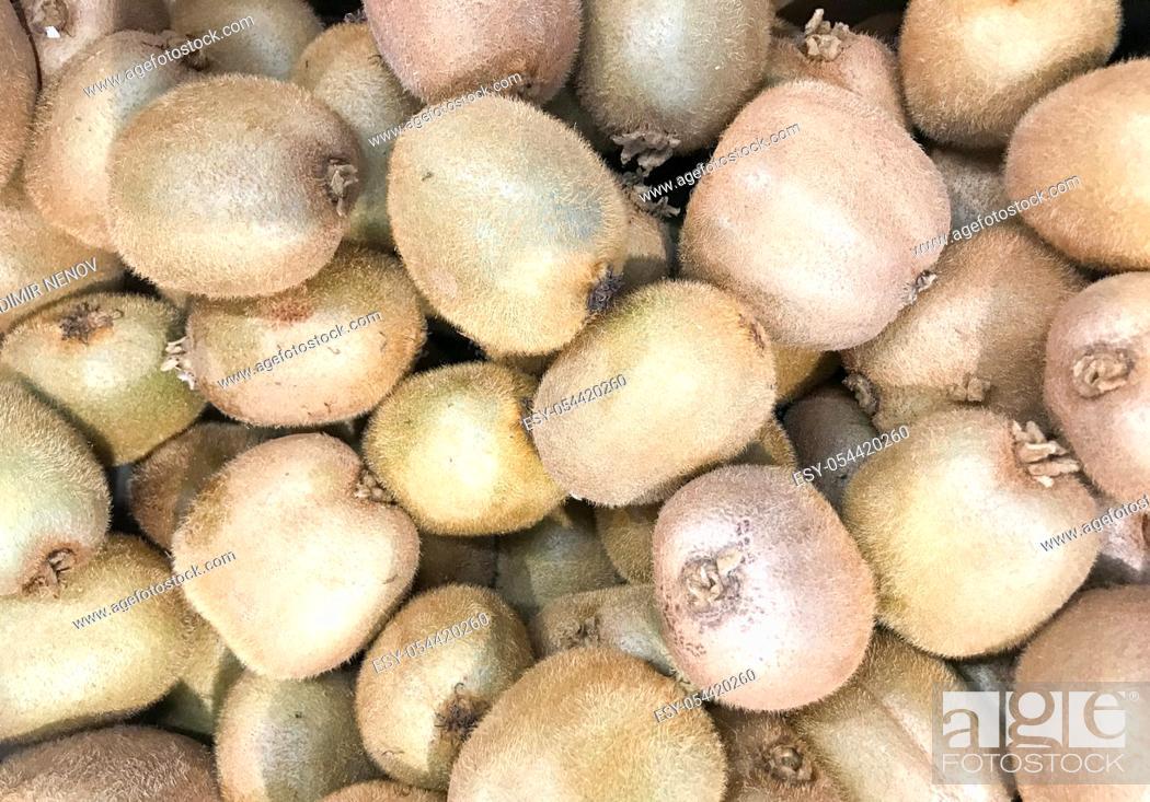 Stock Photo: Close-up of kiwifruit on the market. Healthy fresh food background.