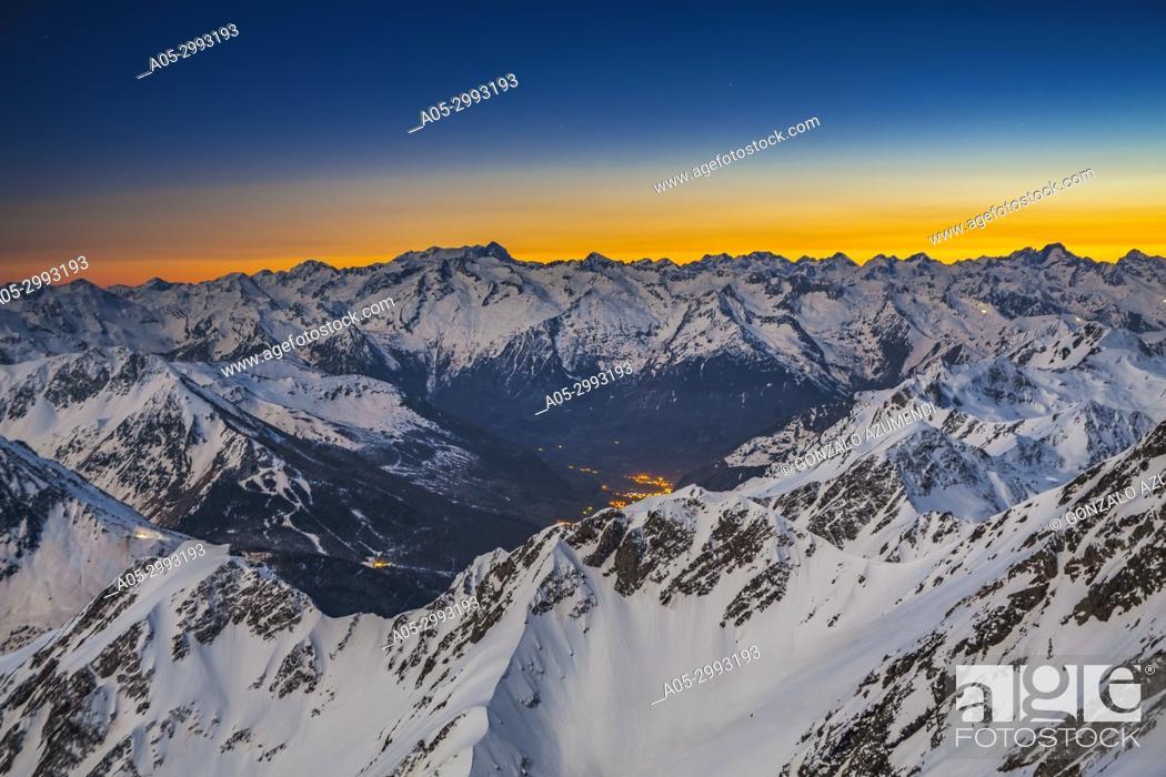 Stock Photo: Sunset and view from Pic du Midi de Bigorre. On the left Vignemale mountain. On the right Balaitus mountain or Pic du Balaitous.