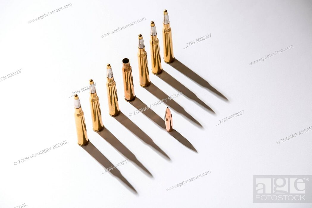 Stock Photo: Macro shot of bullet casings on a white studio background.