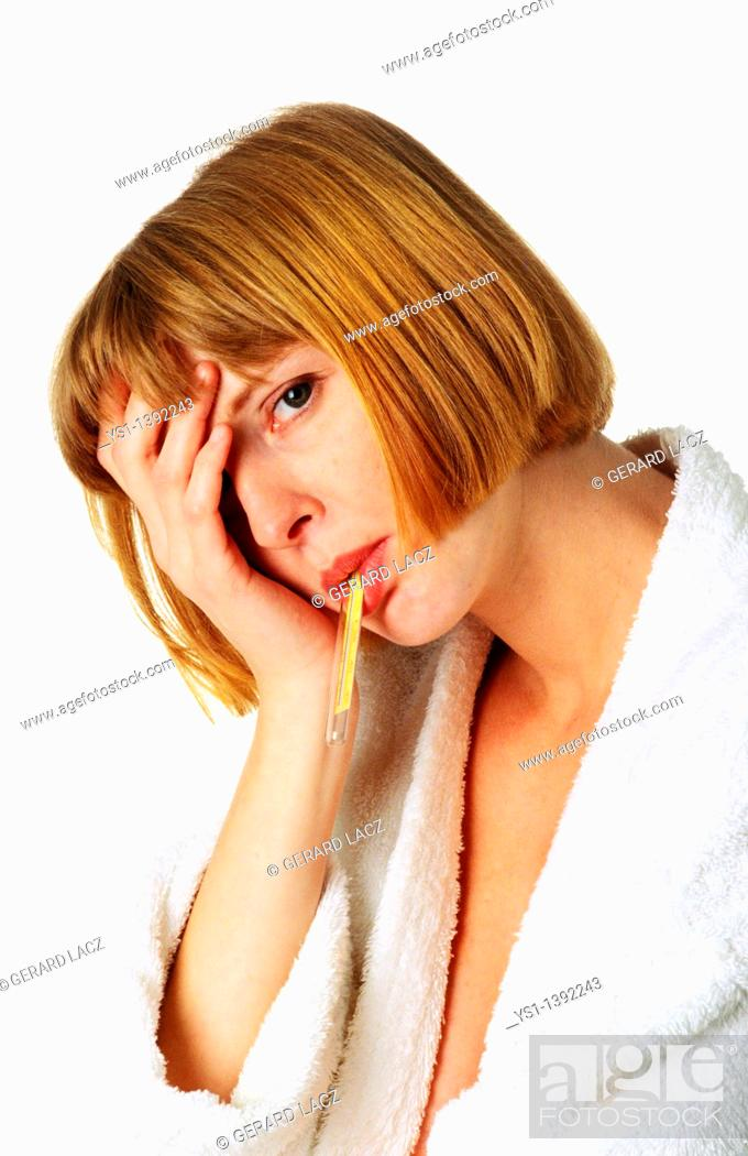 Stock Photo: Woman in Bath Robe taking her Temperature.