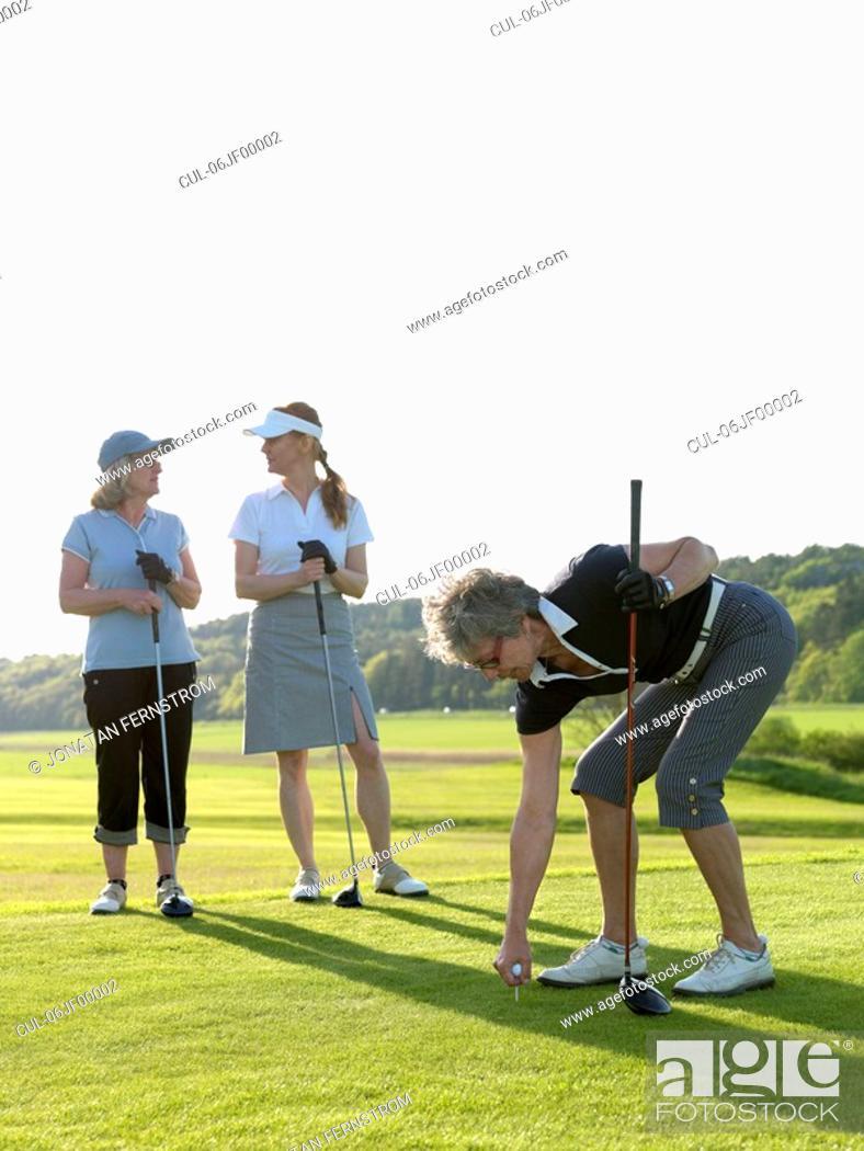 Stock Photo: Three golf ladies at tee.