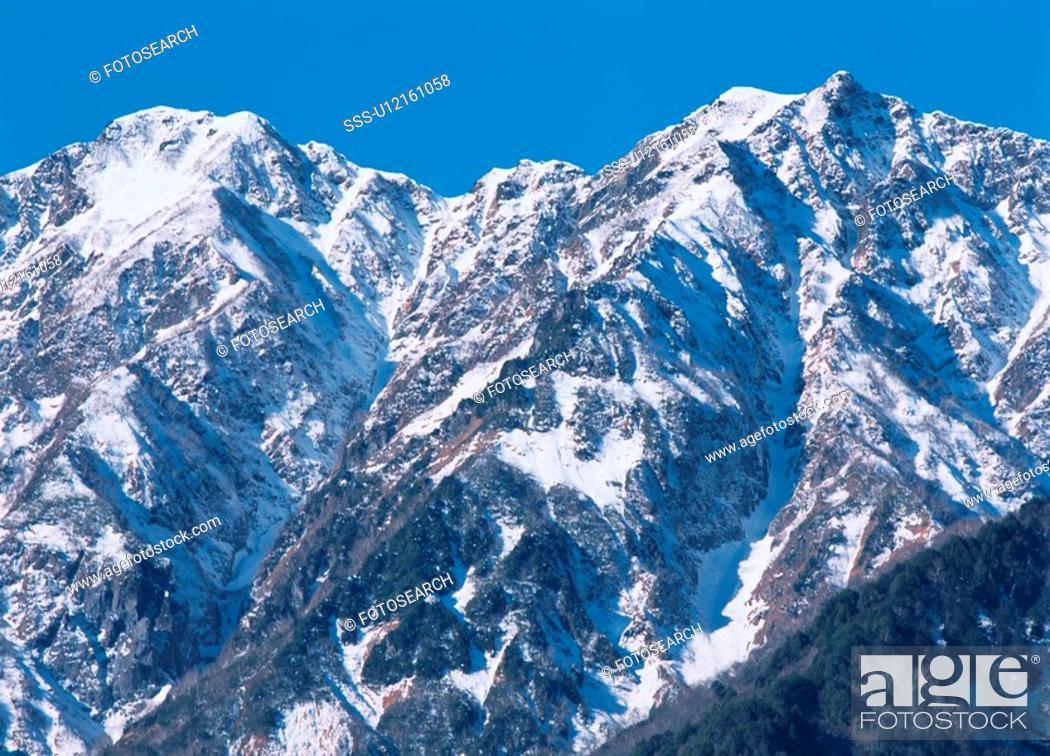Stock Photo: Snow On Mountain Peaks.
