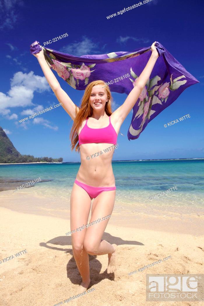33d31d2c34b27 Stock Photo - Portrait of a young woman on Tunnel s Beach  Kauai