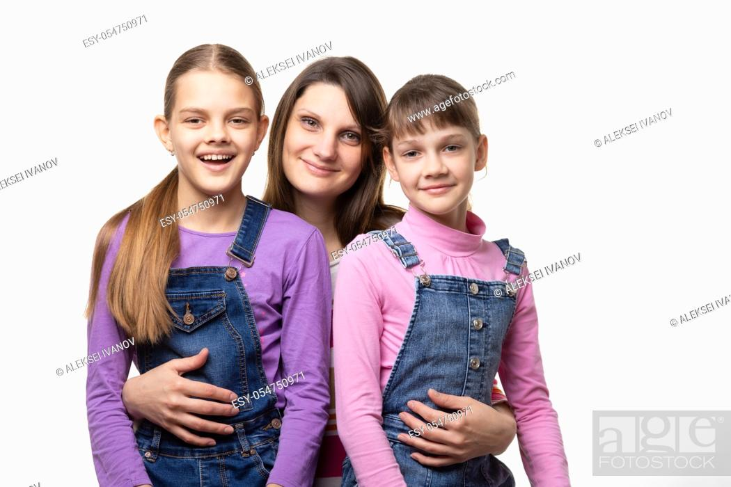 Stock Photo: Portrait of a family, mom with two daughters, on a white background.