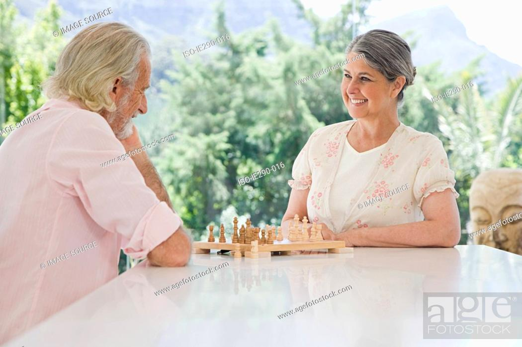 Stock Photo: A senior couple playing chess.