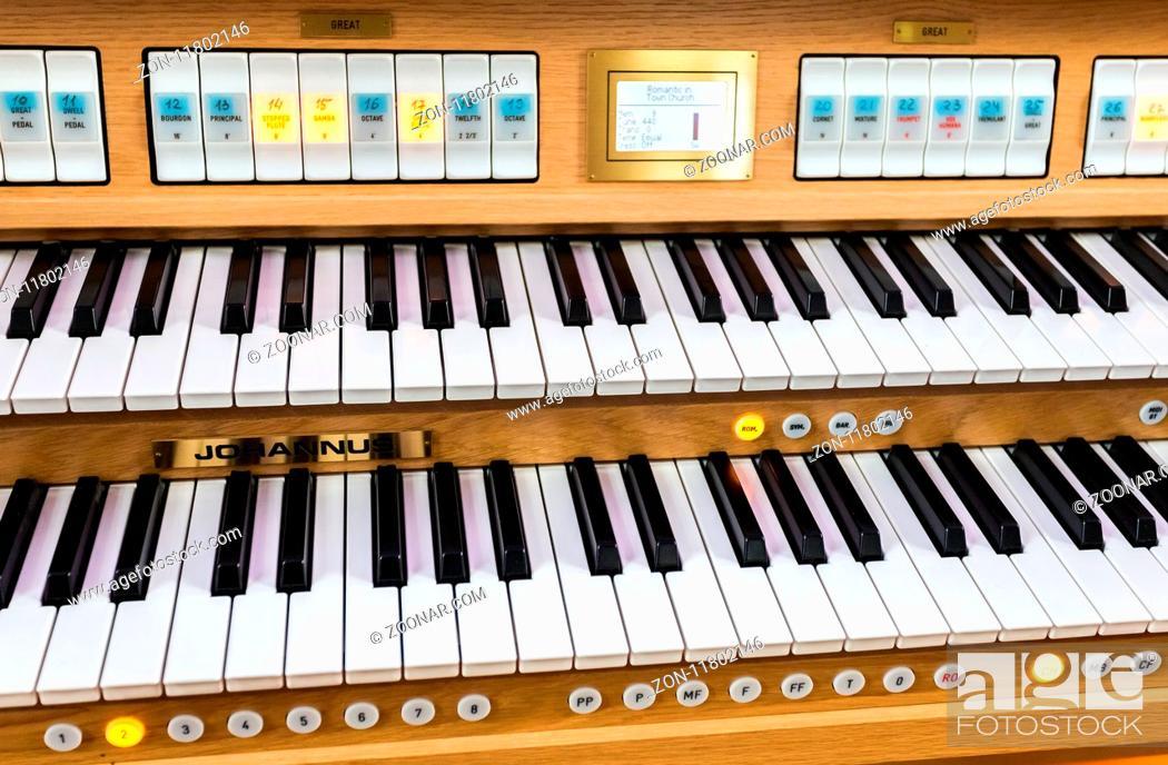 Stock Photo: Samara, Russia - February 25, 2018: Electronic organ at the Roman Catholic parish of the sacred Heart of Jesus.
