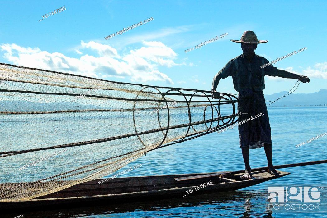 Stock Photo: Man fishing at Inle Lake in Burma Myanmar.
