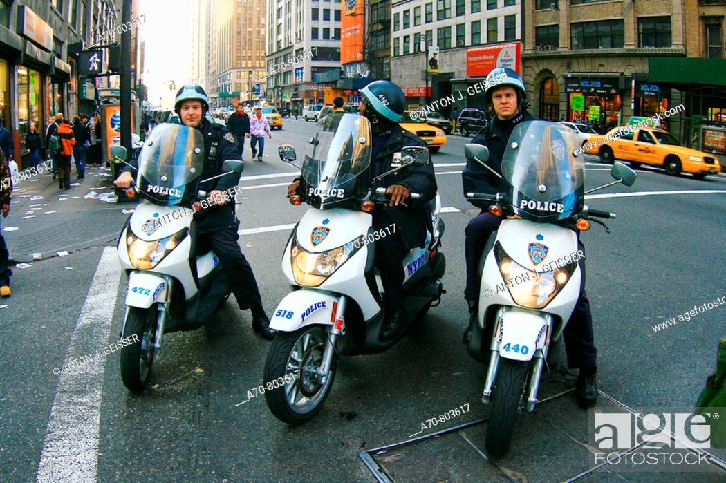 Stock Photo: USA, New York City, policemen on motorcycles.