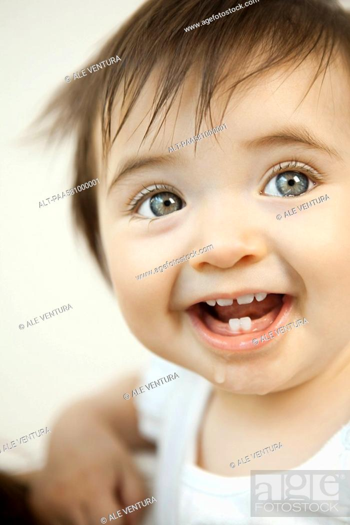 Stock Photo: Baby girl smiling, portrait.