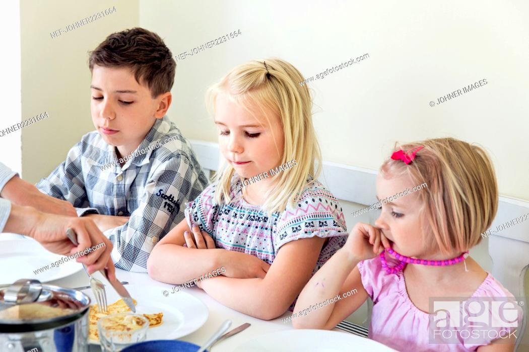 Stock Photo: Children having meal.
