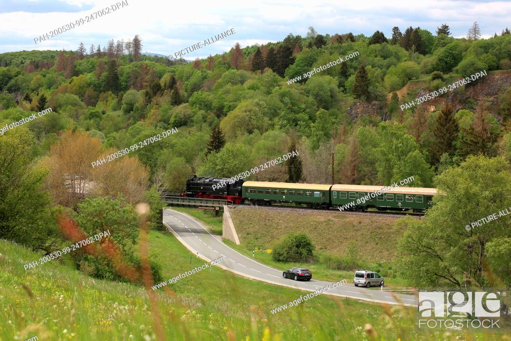 Stock Photo: 30 May 2020, Saxony-Anhalt, Rübeland: The Bergkönigin travels on the single-track line of the Rübelandbahn (formerly Harzbahn) near Rübeland in the Harz.